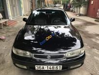 Cần bán xe Mazda 626 1.8 năm sản xuất 1997, màu đen, nhập khẩu, giá chỉ 180 triệu