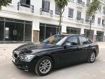 Bán xe cũ BMW 320i đời 2013, màu đen, nhập khẩu