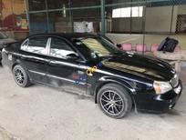 Bán Daewoo Magnus 2.5L năm sản xuất 2004, màu đen chính chủ, 130tr