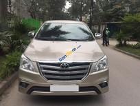 Chính chủ bán xe Toyota Innova 2.0E sản xuất 2015, màu vàng