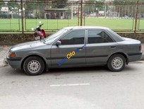 Cần bán xe Mazda 323 năm sản xuất 1994, màu xám, nhập khẩu nguyên chiếc giá cạnh tranh