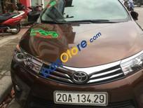 Bán Toyota Corolla altis 1.8 AT sản xuất 2015, màu nâu, giá 660 triệu