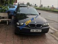 Cần bán gấp BMW 3 Series 318i năm 2003, màu đen chính chủ, máy chất, gầm chắc