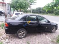 Bán Mazda 323 năm sản xuất 2000, màu đen, nhập khẩu