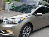 Bán Kia K3 1.6 AT sản xuất năm 2013, màu vàng còn mới