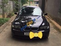 Cần bán xe cĩ BMW 318i đời 2005, màu đen