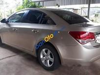 Cần bán Chevrolet Cruze LS 1.6 MT sản xuất 2010, màu vàng xe gia đình