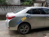 Bán xe Toyota Corolla altis 1.8G năm sản xuất 2015, màu bạc