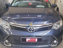 Bán lại xe Toyota Camry E sản xuất năm 2015, màu xanh lam, giá chỉ 889 triệu