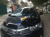 Bán gấp xe cũ Toyota Corolla altis 1.8G AT 2015, màu đen như mới