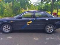 Bán Ford Laser 1.8MT năm sản xuất 2003, màu đen