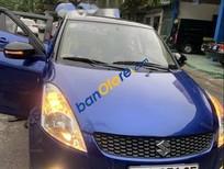 Gia đình bán Suzuki Swift đời 2014, màu xanh lam, đi siêu tiết kiệm xăng chỉ 5.5L đường trường