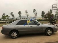 Cần bán Mazda 626 năm sản xuất 1995, màu xám, xe nhập