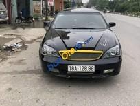 Cần bán xe Daewoo Magnus MT năm 2004, màu đen giá cạnh tranh