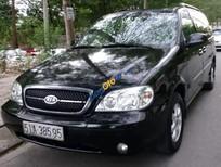 Cần bán xe Kia Carnival năm 2006, màu đen, giá chỉ 250 triệu