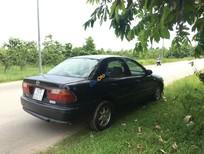 Cần bán Mazda 323 năm sản xuất 1998, màu đen, nhập khẩu, Bs 82 chính chủ ký giấy 1 nốt nhạc