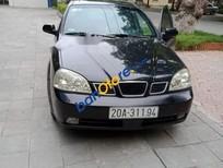 Cần bán Daewoo Lacetti sản xuất 2004, màu đen, giá chỉ 125 triệu