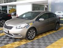 Cần bán gấp Kia K3 1.6MT sản xuất 2015, màu vàng