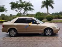 Xe Ford Laser 1.8 AT sản xuất 2003, màu vàng