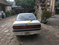 Bán ô tô Mazda 323 sản xuất năm 1996, màu trắng, nhập khẩu nguyên chiếc