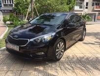 Cần bán lại xe Kia K3 1.6AT sản xuất năm 2014, màu đen
