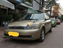 Cần bán gấp Ford Laser sản xuất 2003, màu vàng