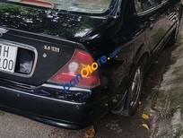 Cần bán gấp Daewoo Magnus năm sản xuất 2004, màu đen xe gia đình, 170 triệu