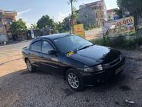 Cần bán Mazda 323 sản xuất năm 2000, màu đen