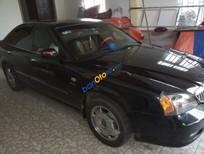 Cần bán gấp Daewoo Magnus năm sản xuất 2004, màu đen, xe nhập số tự động, 172tr