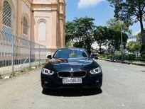 Cần bán BMW 3 Series 320i sản xuất năm 2014, màu đen, nhập khẩu nguyên chiếc, giá 880tr