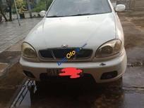 Cần bán gấp Daewoo Lanos năm sản xuất 2002, màu trắng