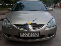 Cần bán Mitsubishi Lancer năm sản xuất 2004, màu vàng số tự động