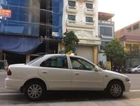 Bán ô tô Mazda 323 sản xuất năm 2000, màu trắng, nhập khẩu nguyên chiếc