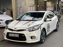 Cần bán Kia Cerato sản xuất năm 2014, màu trắng, nhập khẩu nguyên chiếc, 560 triệu
