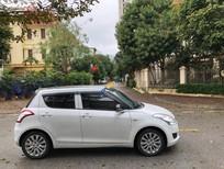 Bán ô tô cũ Suzuki Swift năm 2014, màu trắng