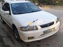 Cần bán gấp Mazda 323 sản xuất 1999, màu trắng, nhập khẩu nguyên chiếc, giá 88tr