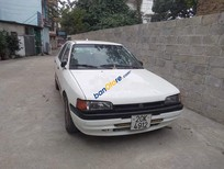 Bán ô tô Mazda 323 sản xuất 1995, màu trắng, giá cạnh tranh