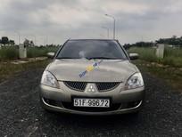 Cần bán lại xe Mitsubishi Lancer sản xuất 2005, màu vàng, giá 248tr