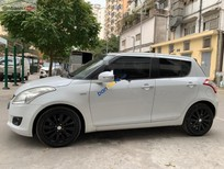 Bán Suzuki Swift 1.4 AT sản xuất năm 2014, màu trắng xe gia đình