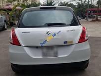 Cần bán xe Suzuki Swift sản xuất năm 2014, màu trắng còn mới