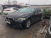 Bán ô tô BMW 320i sản xuất 2015, màu đen, form 2016