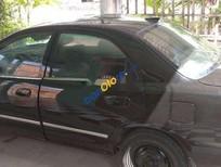 Bán Mazda 323 năm 2000, màu đen, nhập khẩu nguyên chiếc, 70 triệu