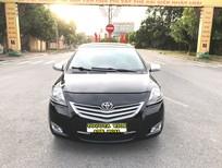 Cần bán Toyota Vios 1.5E 2011, màu đen, giá 320tr