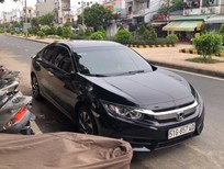 Cần bán gấp Honda Civic 1.8E 2018, màu đen, nhập khẩu chính hãng, 690tr, odo<6,300km