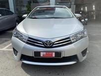 Cần bán Toyota Corolla Altis 1.8G 2015, màu bạc, giá thương lượng