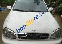 Cần bán gấp Daewoo Lanos MT đời 2001, màu trắng số sàn