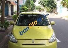 Cần bán Mitsubishi Mirage sản xuất năm 2013, màu vàng xe gia đình giá cạnh tranh