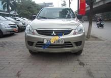 Cần bán xe Mitsubishi Zinger đời 2010, màu vàng