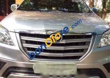 Cần bán Toyota Innova E 2.0 đời 2015, màu bạc xe gia đình