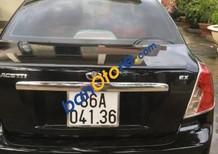 Gia đình bán ô tô Daewoo Lacetti năm 2004, màu đen